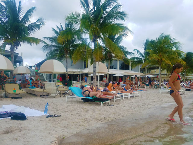 People lounging on the beach while traveling Curacao